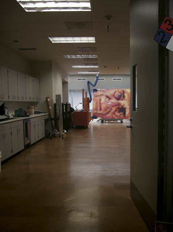 Chuck Close relaxes in the paintings laboratory.