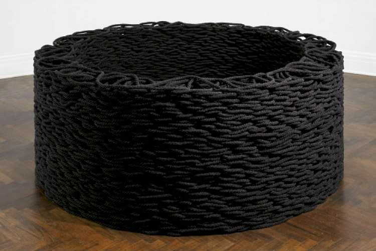 Liza Lou (American, b. 1969). Continuous Mile (Black), 2008. Cotton and glass beads, 1.9 x 160,934.4 cm (78.7 x 195.6 cm installed). Gift of Scott C. Mueller and Margaret Fulton Mueller and John L. Severance Fund 2009.2
