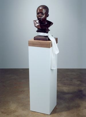 Ota Benga (detail), 2008. Bronze with silk scarf and wood base; 151.1 x 30.5 x 30.5 cm. Edition of 5 + 2APs. © Fred Wilson, courtesy of Pace Gallery. Photo: Courtesy Pace Gallery