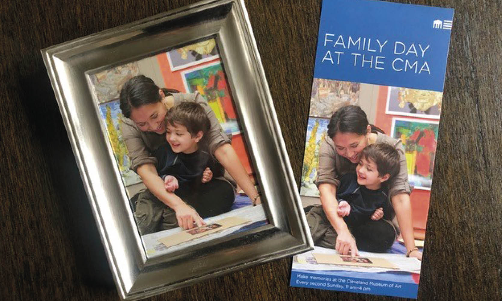 The image of a mother and her young son are featured in both a framed photograph and brochure laid side-by-side