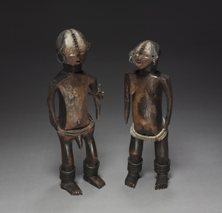Figure Pair, late 1800s–early 1900s. Democratic Republic of the Congo, probably Ngbandi people. Wood, copper, glass beads, iron, fabric; h. 45 and 41 cm. René and Odette Delenne Collection, Leonard C. Hanna Jr. Fund 2010.459.1–2.