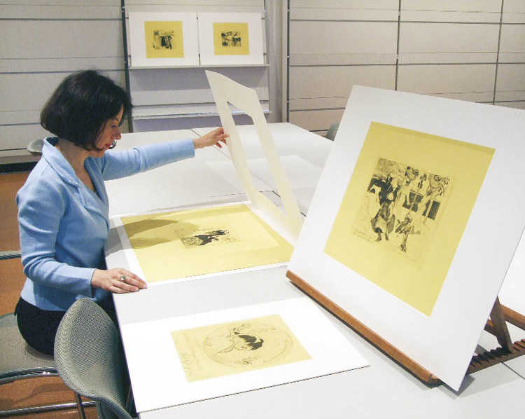 Heather Lemonedes examines the zincographs in the museum's print study room.