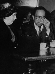 Langston Hughes sits at a table with four performers at the Karamu Theater.  Courtesy of the Karamu House.  From the Website: https://case.edu/ech/articles/k/karamu-house/