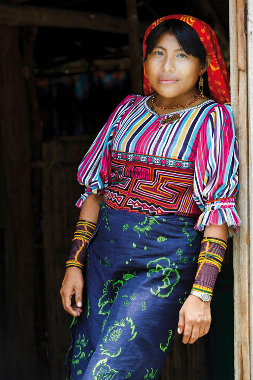 Fig. 3 A Guna woman's dress ensemble combines her handmade mola with a wrap skirt and headscarf. <br>Photo/Foto: Hemis / Alamy