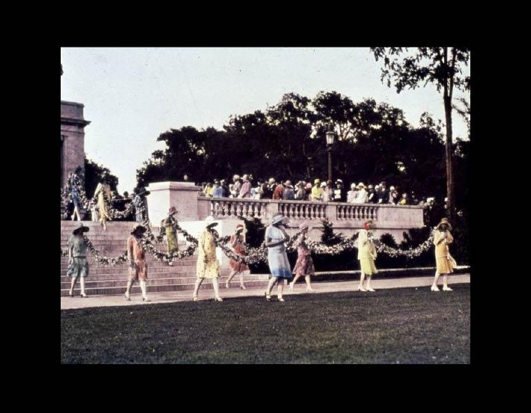 Introduced by a fanfare of trumpets, a daisy-chain was carried from the museum entrance to the Fountain of Waters by twenty-eight young women representing the donors who made the Fine Arts Garden possible. Cleveland Museum or Art. Archives. Records of the Fine Arts Garden.