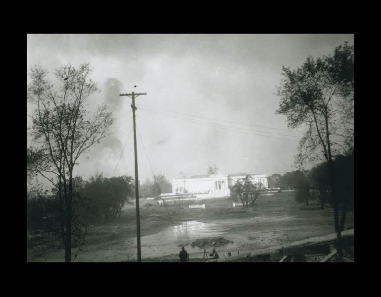 Fine Arts Garden during construction, looking over the drained lagoon toward the museum's 1916 building façade. Cleveland Museum or Art. Archives. Records of the Fine Arts Garden.