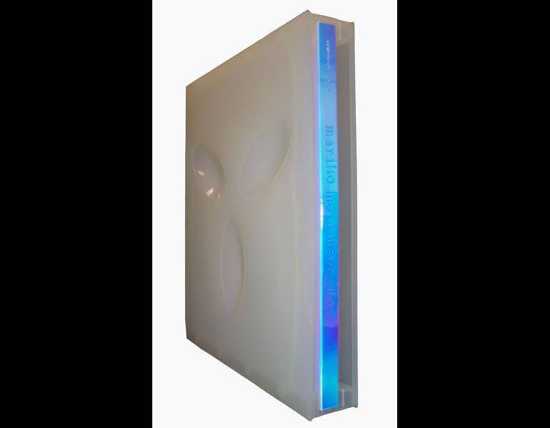 Mariko Mori: wave ufo is a bound volume placed in a plastic case with three concave grooves in the shape of an alien face to represent the subtitle. Call number: N7359.M67 A4 2003