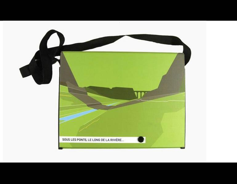 """Sous les ponts, le long de la riviere... can be used as an actual """"handbag"""" for easy access to the exhibition materials (map, guide, catalogs) inside while moving about town to see the site-specific installations. Call number: N6494.I56 S68 2001"""