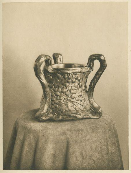 Three-Handled Cup, decorated with grape clusters (page 34B).