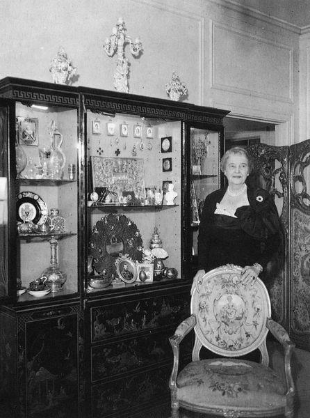 India Early Minshall standing beside a cabinet containing Russian material, ca. 1960, p. 97. Minshall, India Early, Fabergé: From the Collection of India Minshall (Cleveland, OH, 1965).