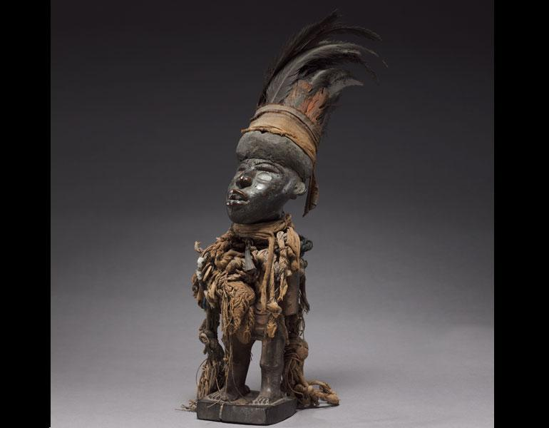 Male Figure, late 1800s–early 1900s. Democratic Republic of the Congo, Cabinda, or Republic of the Congo, probably Vili people. Wood, fabric, shells, beads, feathers, resin, glass, twine or cord; h. 42 cm. René and Odette Delenne Collection, Leonard C. Ha