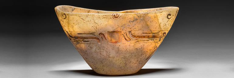 Carved Vessel, 1200–300 BC. Mexico, Olmec, Formative Period. Stone and traces of red pigment; 13.3 x 23.5 x 10.2 cm. John L. Severance Fund 2013.29