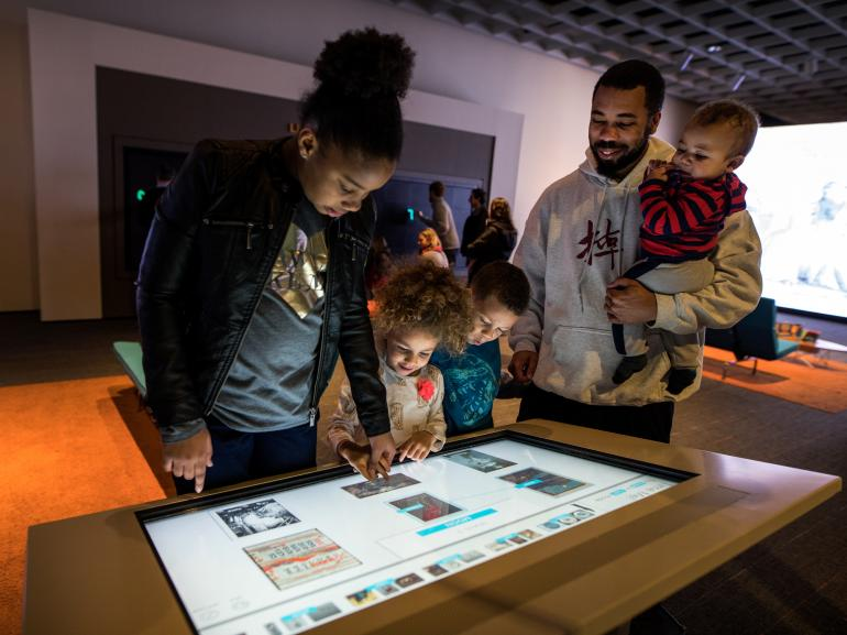 A family plays the Match and Sort game in ArtLens Studio