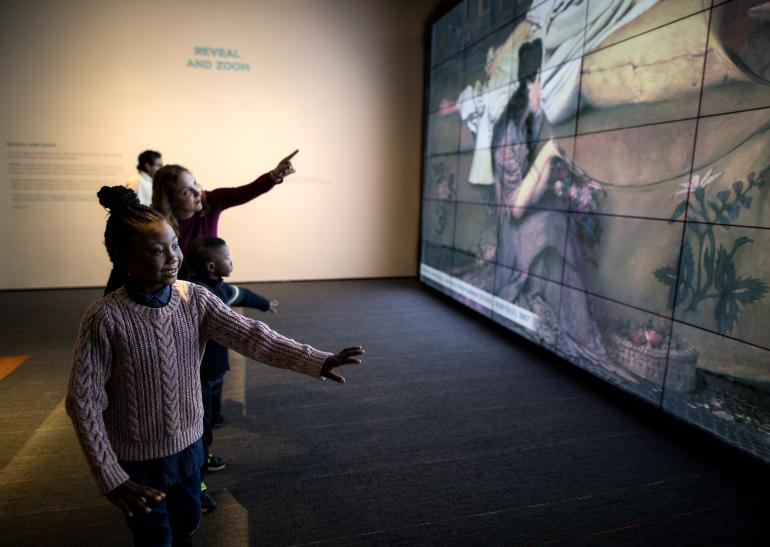 Visitors explore the Zoom and Reveal Wall in ArtLens Studio