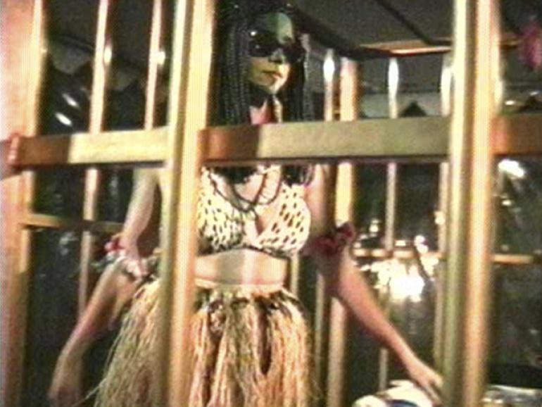 """Still image from """"The Couple in the Cage: Guatinaui Odyssey,"""" 1993. Coco Fusco & Paula Heredian"""