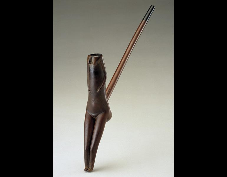 Pipe, 1800s–1900s. Lesotho, Southern Sotho people, or South Africa, Nguni people. Wood, iron; h. 37 cm. National Museum of African Art, Smithsonian Institution, Washington, D.C. (Museum purchase, 89-14-16). Photo: © National Museum of African Art, photography by Franko Khoury