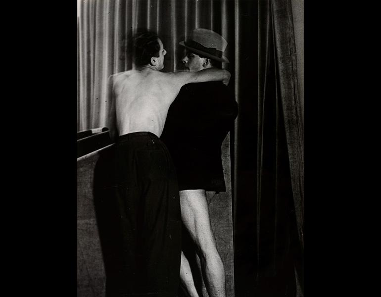 Young Couple Wearing a Two-in-One Suit at the Bal de la Montagne Sainte-Geneviève, 1931. Brassaï  (French, 1899–1984). Gelatin silver print, ferrotyped; 29.8 x 22 cm.  The Cleveland Museum of Art, John L. Severance Fund 2007.40. © The Brassaï Estate – RMN