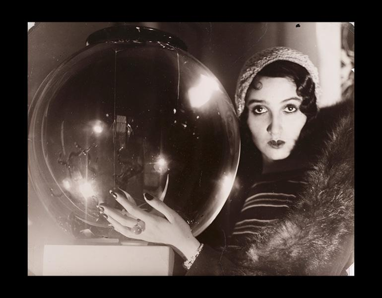 """The Crystal Ball (La Boule de Verre), 1931. Jacques-Henri Lartigue (French, 1894–1986). Gelatin silver print, toned; 23.7 x 29.9 cm. The Cleveland Museum of Art, John L. Severance Fund 2007.149. Photograph by Jacques Henri Lartigue © Ministère de la Cult"