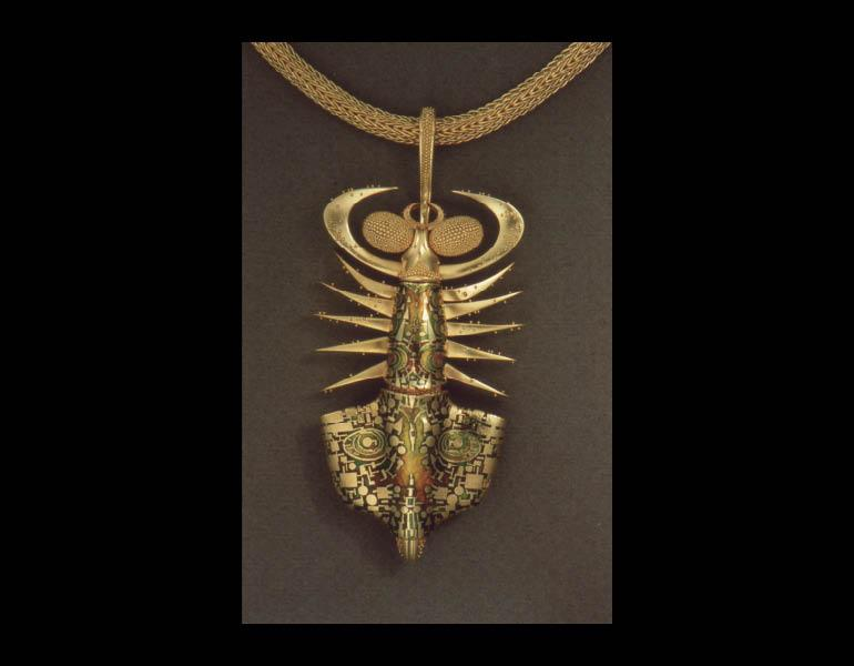 Helgramite Pendant Brooch, 1988. John Paul Miller (American, b. 1918). Gold, enamel. Collection of Barbara G. Fleischman © John Paul Miller
