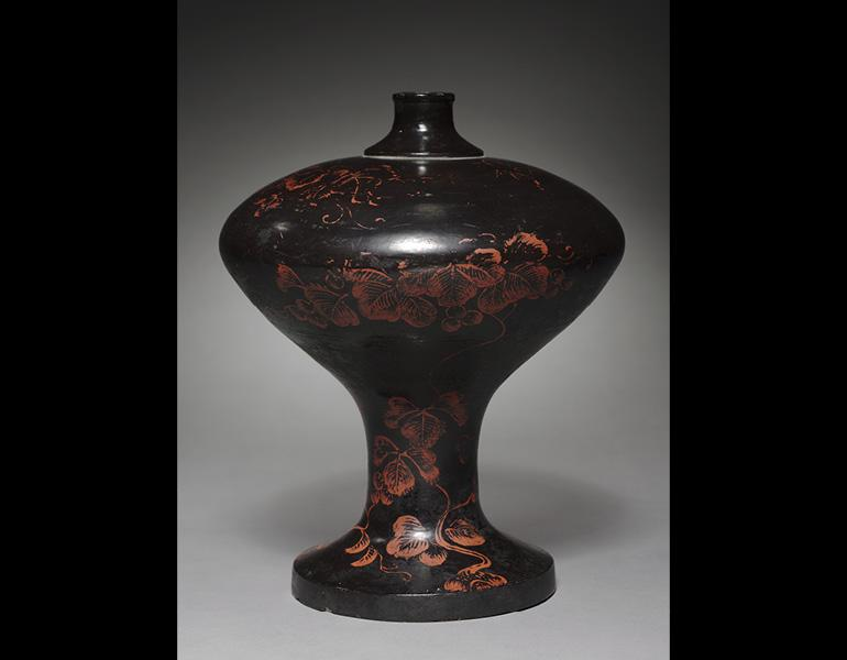 Sake Flask, 1500s. Japan, Muromachi period. Black laquered wood with grape designs painted in red lacquer; h. 30.5 cm. Seventy-fifth anniversary gift of Mitsuru Tajima 1991.47.2