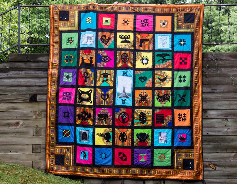 colorful quilt hanging outside