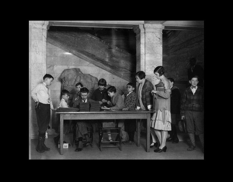 Museum instructor Charles Ramus registering children for Saturday art classes, March 16, 1928. Photograph Collection, CMA Archives.