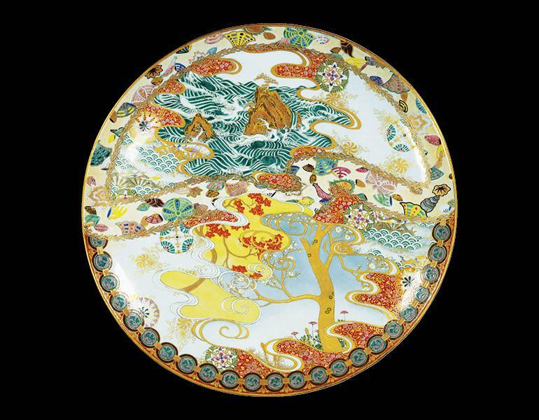 Large Dish with Stormy Coast, Shell, Autumn Foliage, and Cherry-Blossom Design in Overglaze Enamel and Gold, 1877 (Meiji 10). Tsuji Katsuzō (1847-1929). Porcelain; 66.7 cm. Tokyo National Museum (G-296)