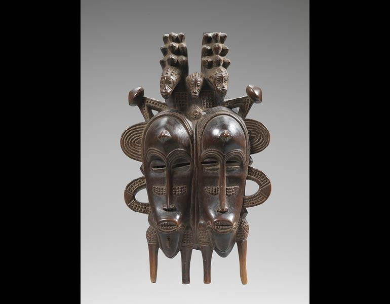 Double Face Mask. Unidentified artist. Wood; h. 32 cm. Collection Laura and James J. Ross. Photo: John Bigelow Taylor.