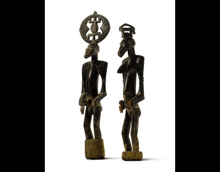Pair of Male and Female Figures. Unidentified artist. Wood; h.: 115 cm and 97 cm. Private Collection, Courtesy McClain Gallery. Photo © Sotheby's.