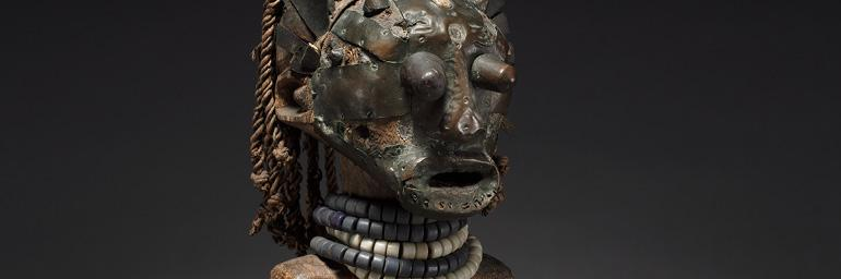Male Figure (detail), early 1800s–early 1900s. Democratic Republic of the Congo, Songye people. Wood, hide, fabric, brass, copper, iron, glass beads, teeth, horn; h. 64 cm. The Cleveland Museum of Art, René and Odette Delenne Collection, Leonard C. Hanna Jr. Fund 2010.451