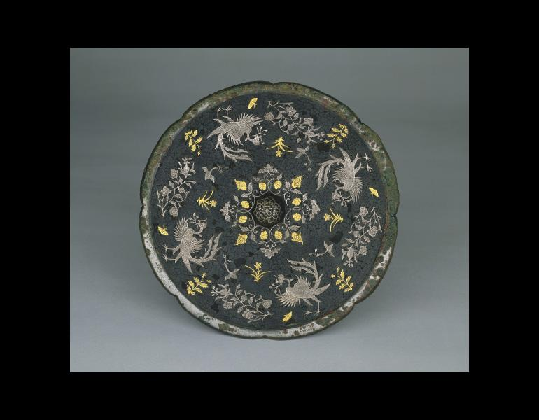 Mirror with Phoenixes, Birds, Butterflies, and Floral Sprays, 700s. China, Tang dynasty (618–907). Bronze with silver and gold inlaid lacquer. Leonard C. Hanna Jr. Fund 1973.74