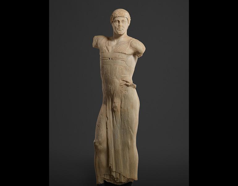 Statue of a Youth (The Mozia Charioteer), 470–460 BC. Sikeliote (Sicilian Greek). Marble; 181 x 40 cm. Courtesy of the Servizio Parco archeologico e ambientale presso le isole dello Stagnone e delle aree archeologiche di Marsala e dei Comuni limitrofi–Museo Archeologico Baglio Anselmi. By permission of the Regione Siciliana, Assessorato dei Beni Culturali e dell'Identità Siciliana. Dipartimento dei Beni Culturali e dell'Identità Siciliana. Unauthorized reproduction prohibited.