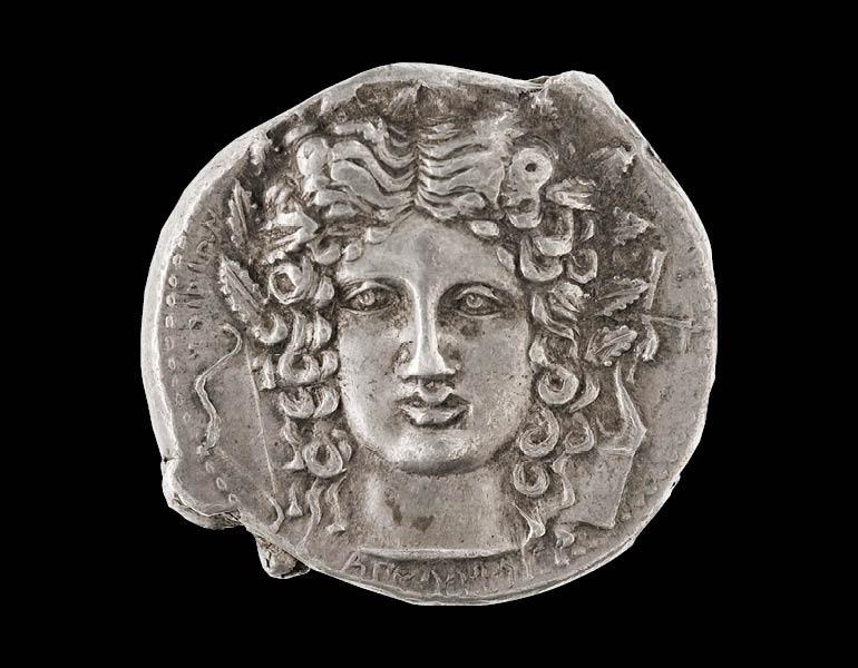 Coin with a Head of Apollo, 410–403 BC. Sikeliote (Sicilian Greek). Silver; diam. 2.8 cm. Courtesy of the Museo Archeologico Regionale Paolo Orsi, Syracuse. By permission of the Regione Siciliana, Assessorato dei Beni Culturali e dell'Identità Siciliana. Dipartimento dei Beni Culturali e dell'Identità Siciliana. Unauthorized reproduction prohibited.