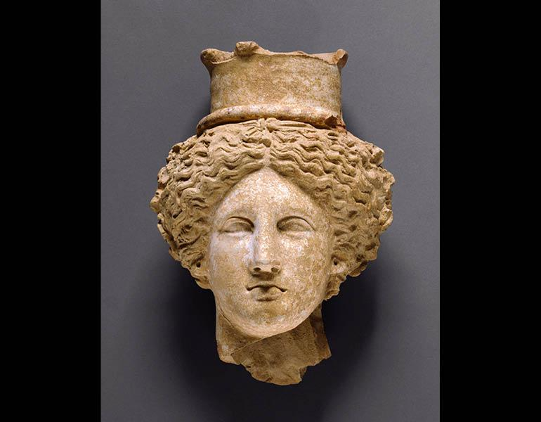 Head of a Goddess, perhaps Demeter or Kore, 350–300 BC. Sicily. Terracotta; 28.8 x 19.1 x 12.2 cm. The J. Paul Getty Museum, Villa Collection, Malibu, California, Gift of Dr. Max Gerchik, 76.AD.34