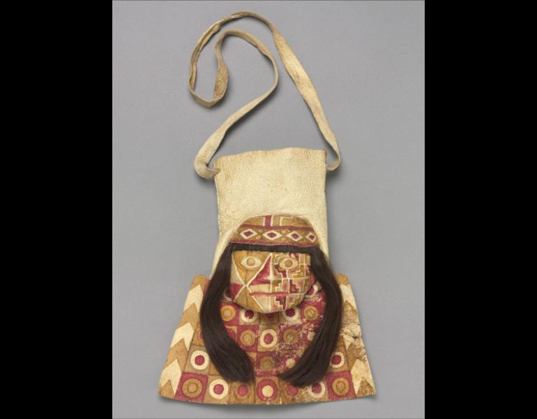 Bag with Human Face, 600–1000. Peru, Wari. Alpaca or llama hide, human hair, pigment, cotton, coca leaf contents; h. 26 cm (bag), l. 64.7 cm (strap). The Cleveland Museum of Art, Leonard C. Hanna Jr. Fund 2011.35. Image © The Cleveland Museum of Art