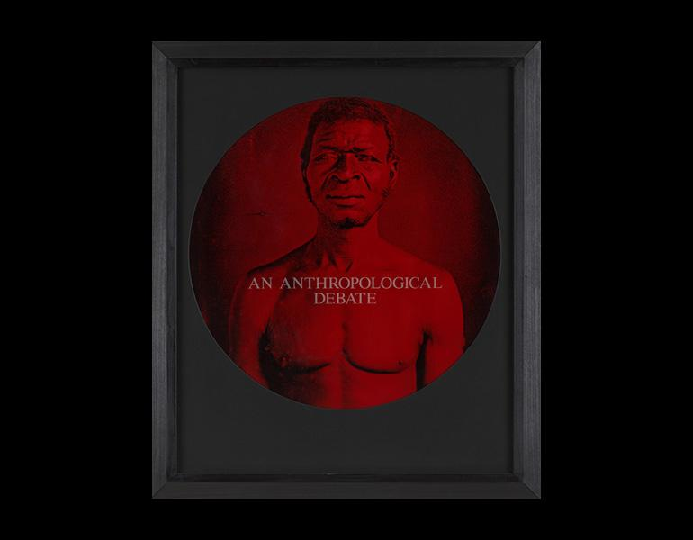 An Anthropological Debate, from From Here I Saw What Happened and I Cried, 1995–96. Carrie Mae Weems (American, born 1953). Chromogenic print with etched text on glass; 26 1/2 x 22 3/4 in. Collection of the Museum of Modern Art, New York, Gift on behalf of the Friends of Education of the Museum of Modern Art. From an original daguerreotype taken by J. T. Zealy, 1850. Peabody Museum, Harvard University. © 1977 President & Fellows of Harvard College. All rights reserved. Digital image © 2012 MoMA, NY.