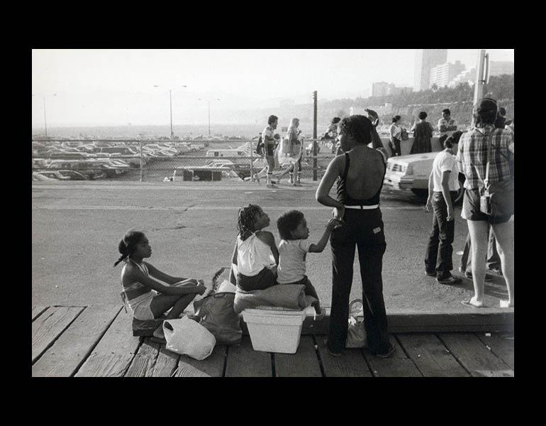 Mother with Children, from Boardwalk, Santa Monica, 1980–82. Carrie Mae Weems (American, born 1953). Gelatin silver print; 9 1/16 x 13 1/8 in. Courtesy of the artist and Jack Shainman Gallery, New York. © Carrie Mae Weems.
