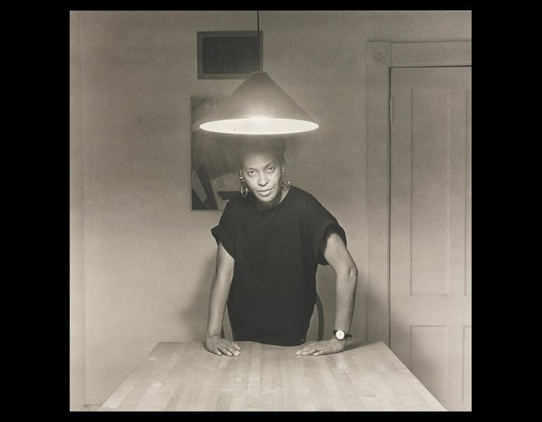 Untitled (Woman Standing Alone), from Kitchen Table Series, 1990. Carrie Mae Weems (American, born 1953). Platinum print; 20 x 20 in. The Cleveland Museum of Art, Purchase from the J. H. Wade Fund 2008.116.20. © Carrie Mae Weems.