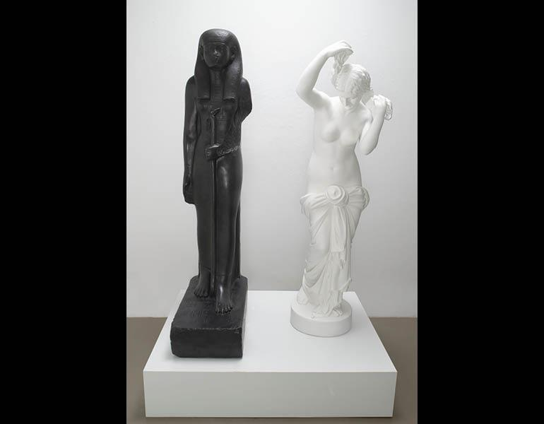 """The Mete of the Muse, 2006. Bronze with black patina and bronze with white paint. Overall: 160 x 106.7 x 66.4 cm (63 x 42 x 26-1/8 in); African figure: 160 x 66.4 x 31.8 cm (63"""" x 26-1/8"""" x 12-1/2""""); European figure: 153 x 43.2 x 43.2 cm  (60-1/4 x 17 x 17 in); Edition of 5 + 2 APs. © Fred Wilson, courtesy Pace Gallery. Photo: Kerry Ryan McFate, Pace Gallery, New York."""