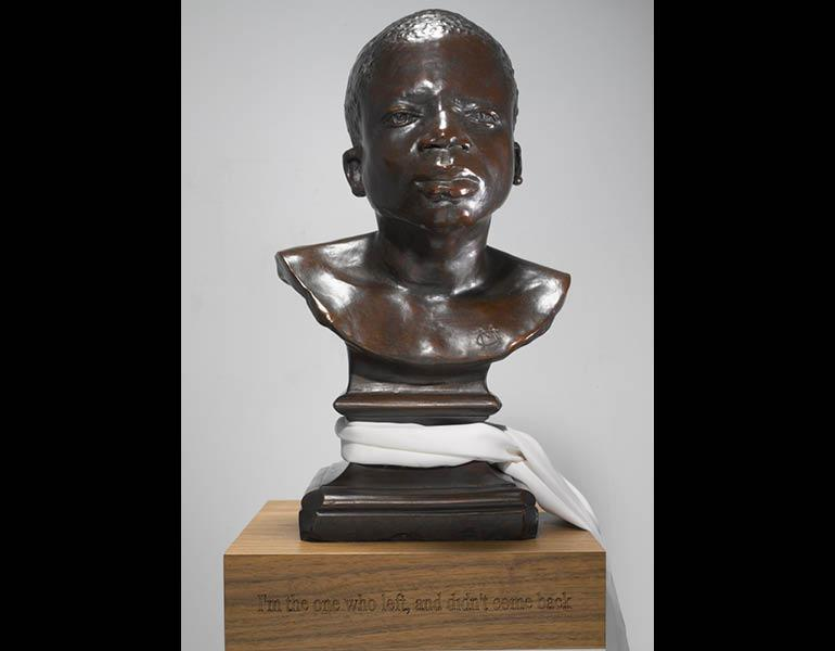 Ota Benga (detail), 2008. Bronze with silk scarf and wood base; 151.1 x 30.5 x 30.5 cm (59-1/2 x 12 x 12 in); Edition of 5 + 2APs. © Fred Wilson, courtesy Pace Gallery. Photo: Pace Gallery, New York