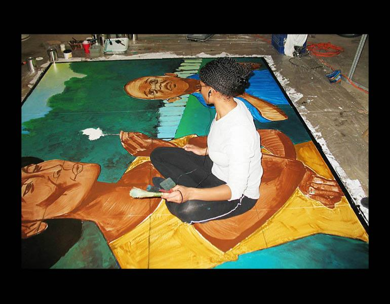 Sequoia Versillee finishes painting her mural, which honors Kathryn R. Tyler, an inspirational leader of the Glenville neighborhood.