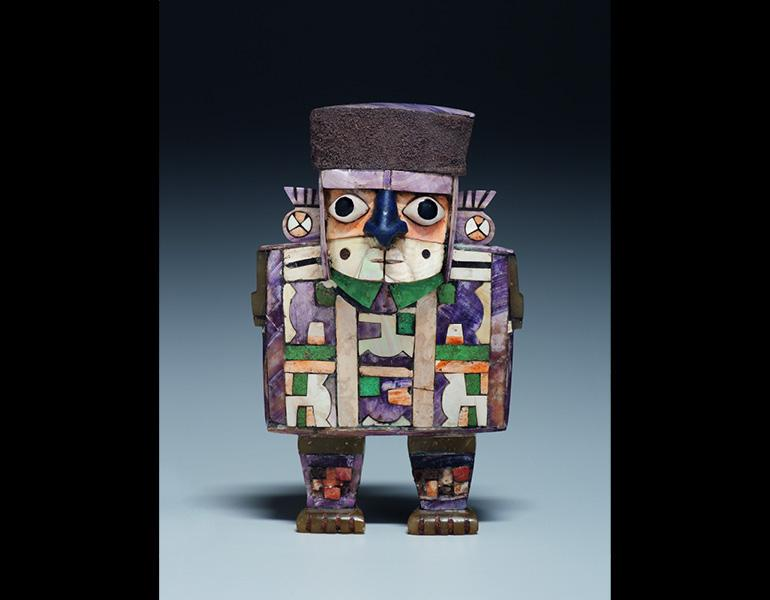 Figure Pendant, 600–1000. Peru, Wari. Wood, shell, stone, and silver; 10.2 x 6.4 x 2.5 cm. Kimbell Museum of Art, Fort Worth AP 2002.04