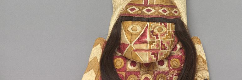 Bag with Human Face (detail), 600–1000. Peru, Wari. Alpaca or llama hide, human hair, pigment, cotton, coca leaf contents; h. 26 cm (bag), l. 64.7 cm (strap). The Cleveland Museum of Art, Leonard C. Hanna Jr. Fund 2011.35. Image © The Cleveland Museum of Art