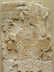 a mesoamerican stone carving shows a female ruler in elaborate cosume
