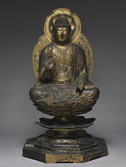 A gilded wood sculpture of a seated buddha